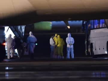 Coronavirus live updates: US confirms 14 new cases, repatriates cruise ship passengers