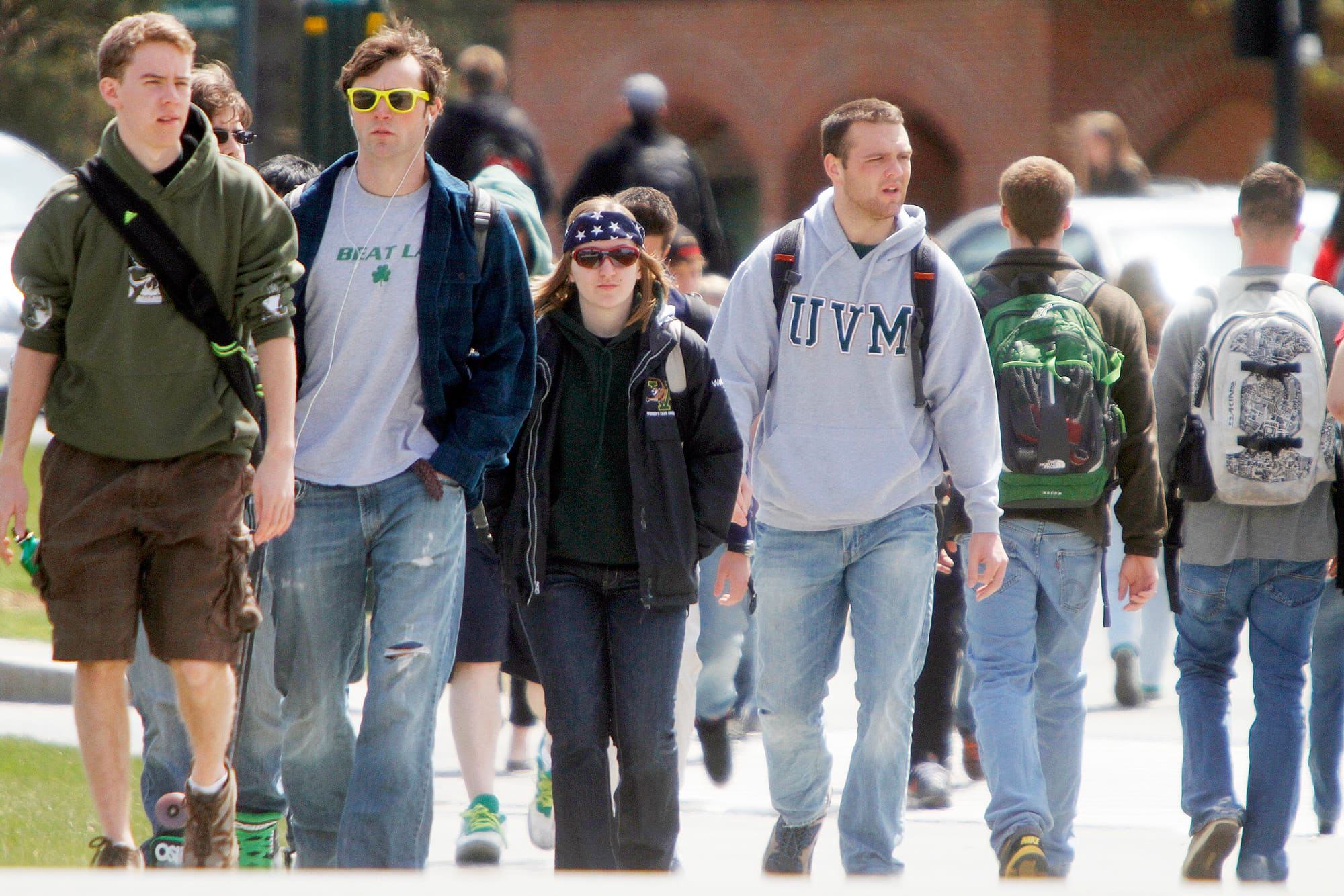 Students walk across campus at the University of Vermont in Burlington.