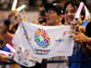 Residents of Olympic bid city Tokyo celebrate while holding Tokyo signs after the announcement of the 2020 Summer Olympic Games host city at Komazawa Olympic Park in Tokyo, Japan.