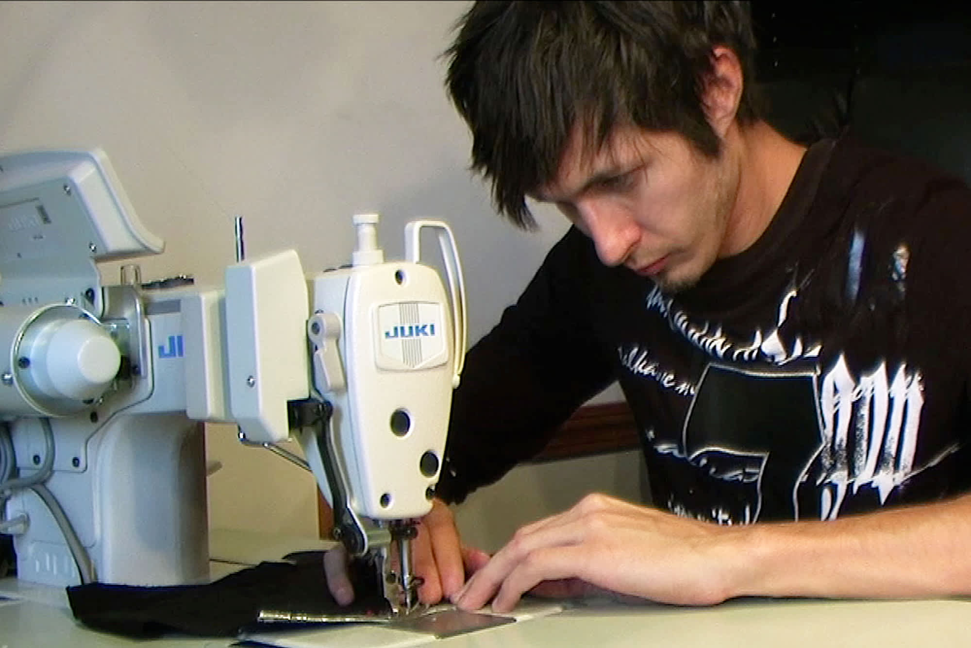 Anton Babich makes custom dress shirts for his emerging company, Anton Alexander, based in Fort Wayne, Ind.