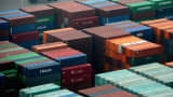 Shipping containers sit stacked at Port of Dalian, China.