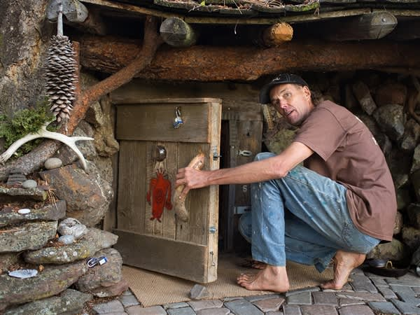 Take a look at Dan Price's ultra-cheap lifestyle, starting with the home he built from scrap wood that he calls his Hobbit hole.