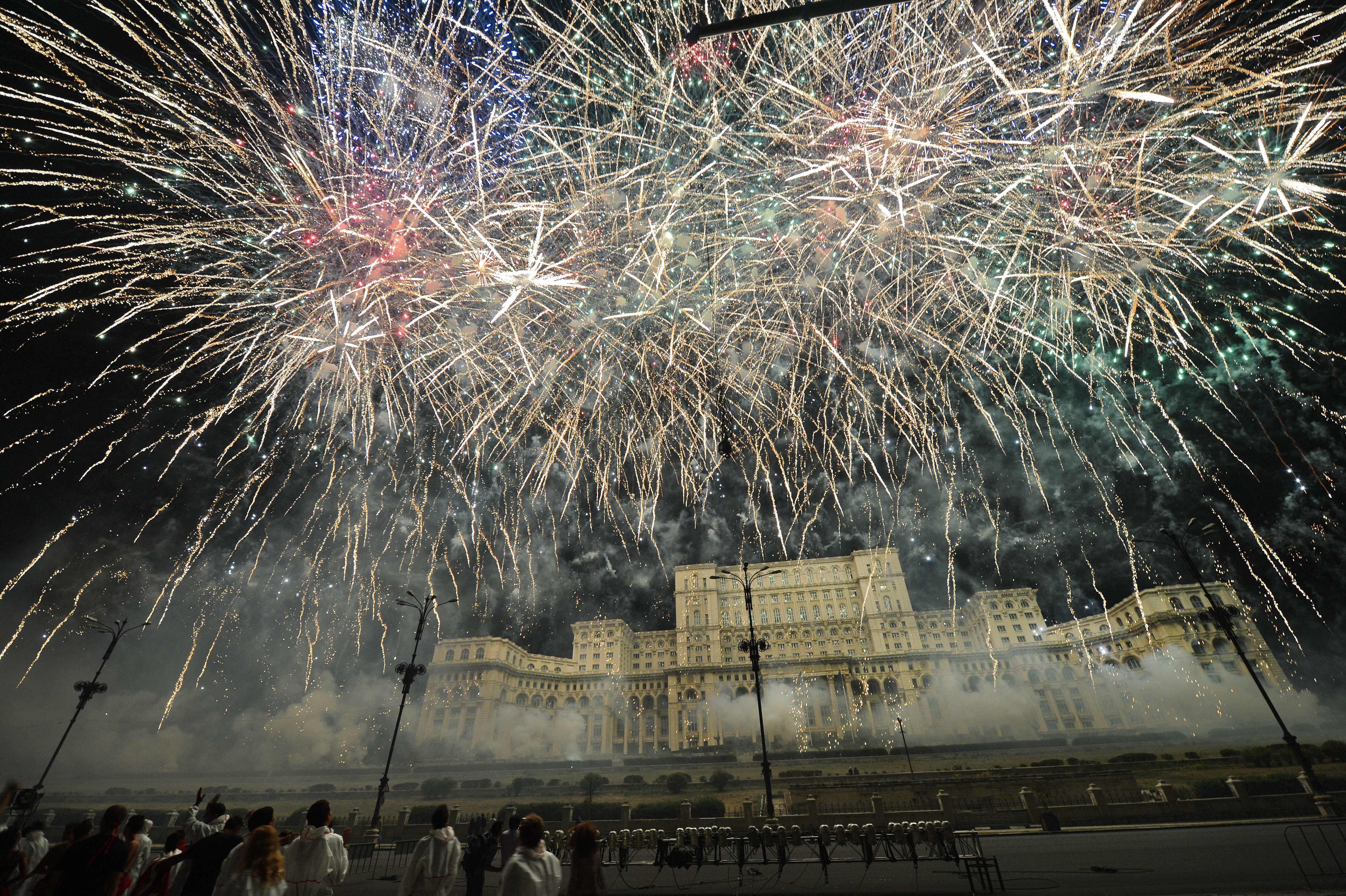 Fireworks illuminating the Romanian Parliament building