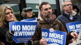 Protesters on Monday in New York call on Cerberus Capital Management to divest its gun holdings.