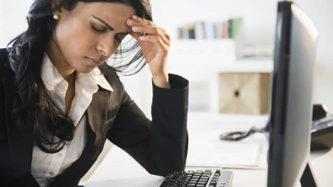 Premium: Woman sick at work office