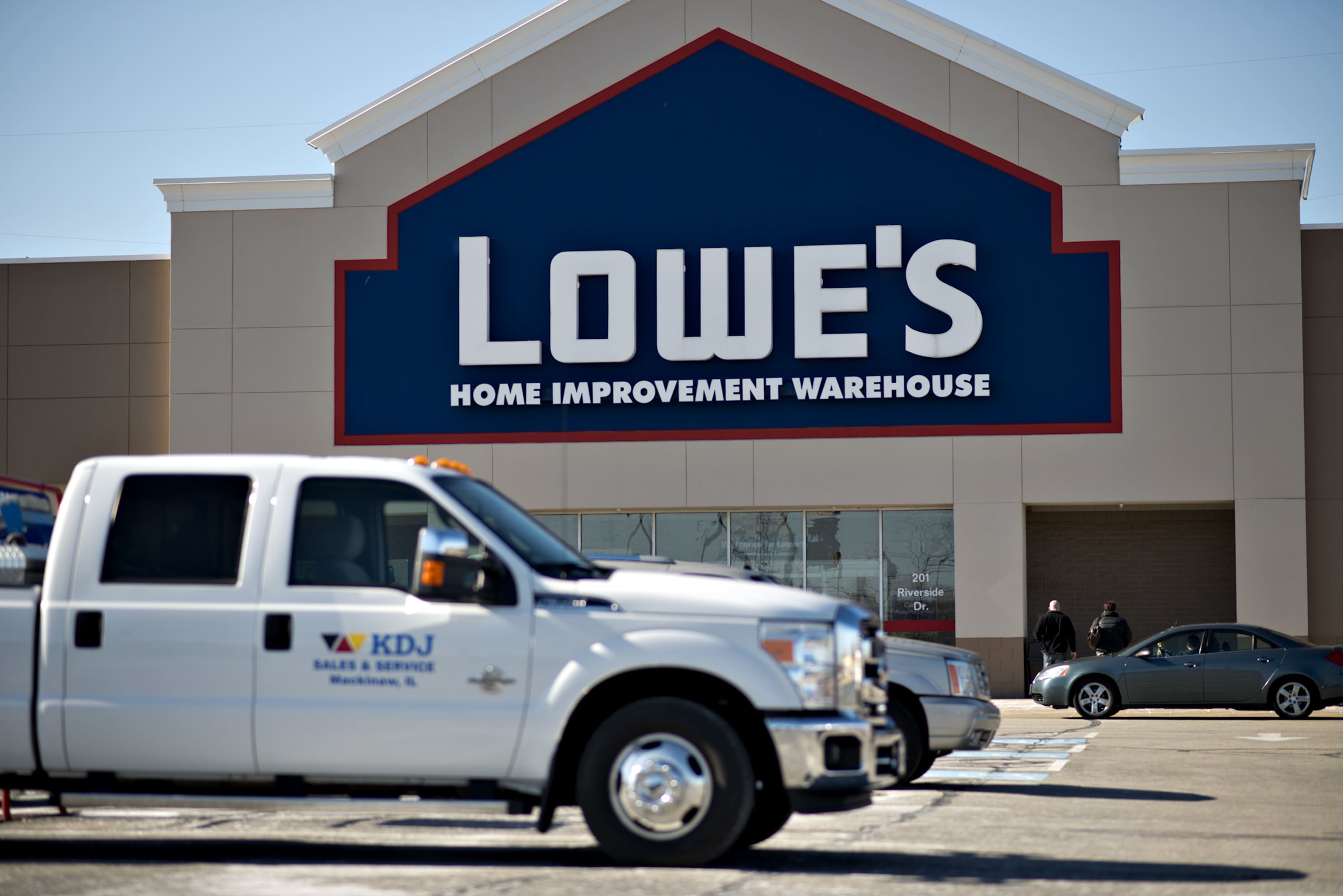 Lowe's tumbles as earnings fall short and forecast cut as higher costs weigh on results