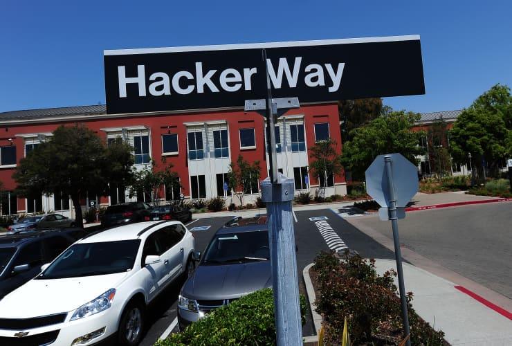 Premium: Hacker Way street Sign Facebook headquarters campus Menlo Park, California