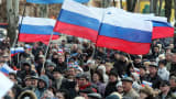 Demonstrators hold Russian flags n the eastern Ukrainian city of Donetsk