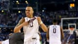 Shabazz Napier #13 of the Connecticut Huskies celebrates on the court after defeating the Kentucky Wildcats 60-54 in the NCAA Men's Final Four Championship at AT&T Stadium on April 7, 2014 in Arlington, Texas.