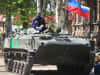 A pro-Russian militant sits on top of an armored personnel carrier (APC) in front of the occupied Ukraine Security Service building on April 21, 2014 in Slovyansk, Ukraine.