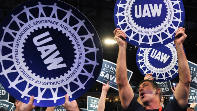 Premium: People hold UAW signs at DNC