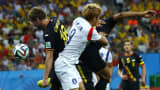 South Korea's Son Heung-min (C) fights for the ball with Belgium's Nicolas Lombaerts (L) and Moussa Dembele during their 2014 World Cup Group H soccer match at the Corinthians arena in Sao Paulo June 26, 2014.