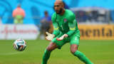 Tim Howard controls the ball during a 2014 FIFA World Cup match between the U.S. and Germany.