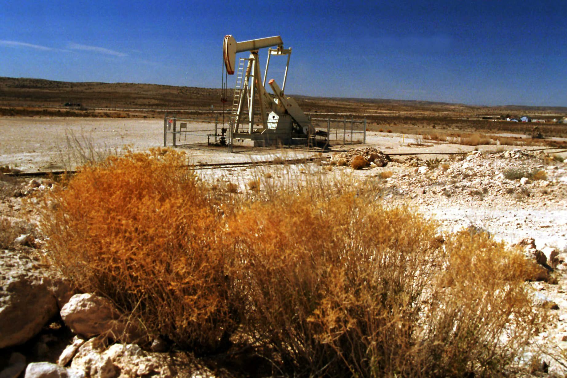 An oil pump operates in the Permian Basin oil field near Carlsbad, New Mexico.