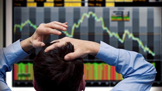 GP - Investor watches screen