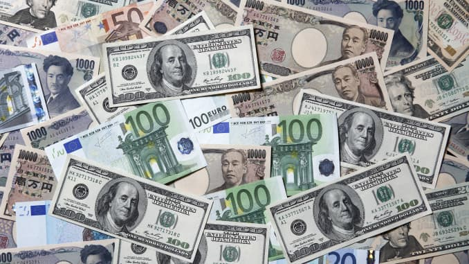 Yen, euro and U.S. dollar banknotes of various denominations.