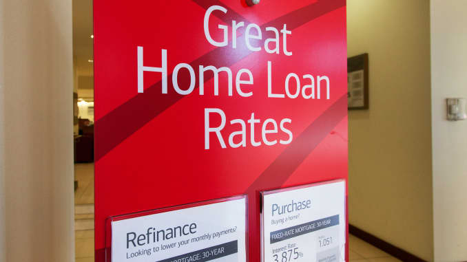 A sign advertising home loan rates for purchase or refinancing at a Bank of America in New York.