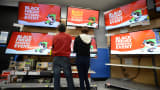 Shoppers consider televisions at a Walmart in Los Angeles on Black Friday.