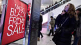 A woman looks for information at Macy's Herald Square in New York during a Black Friday sale.