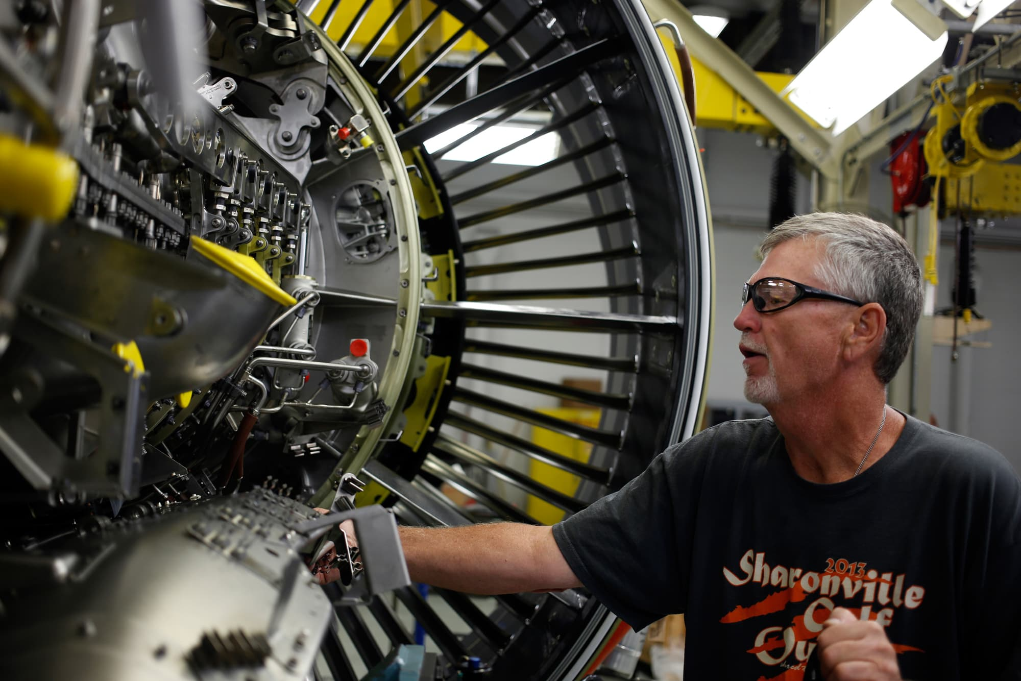 A production assembly mechanic works at the GE Aviation factory in Cincinnati.