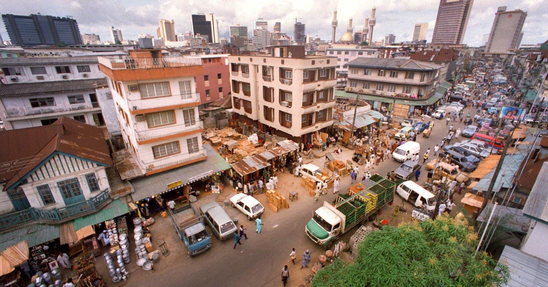 Jankara market, located on Lagos Island and the skyline of Lagos, Nigeria.
