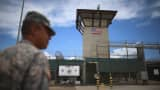 A military officer stands near the entrance to Camp VI at the U.S. military prison for 'enemy combatants' in Guantanamo Bay, Cuba.