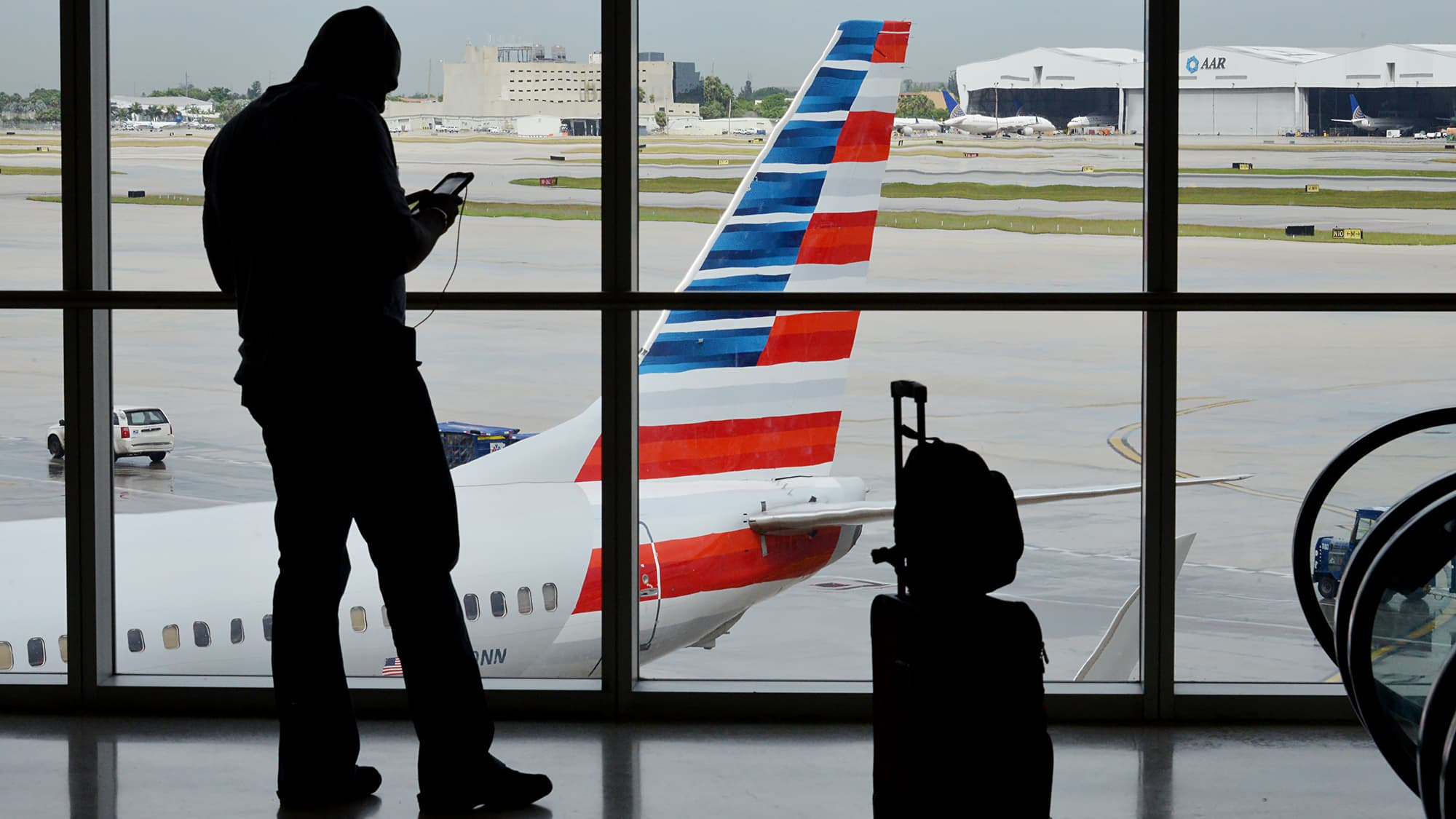 American Airlines plans for layoffs, buyouts due to US Airways merger