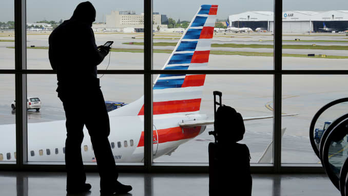 American Airlines plans for layoffs, buyouts due to US