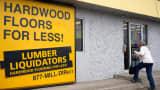A customer enters the Lumber Liquidators store in Denver.