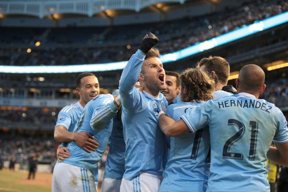 NYCFC players celebrate during the team's home opener at Yankee Stadium.