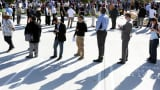 People line up for a job fair at a new Virgin Galactic and The Spaceship Company facility in Long Beach, California.