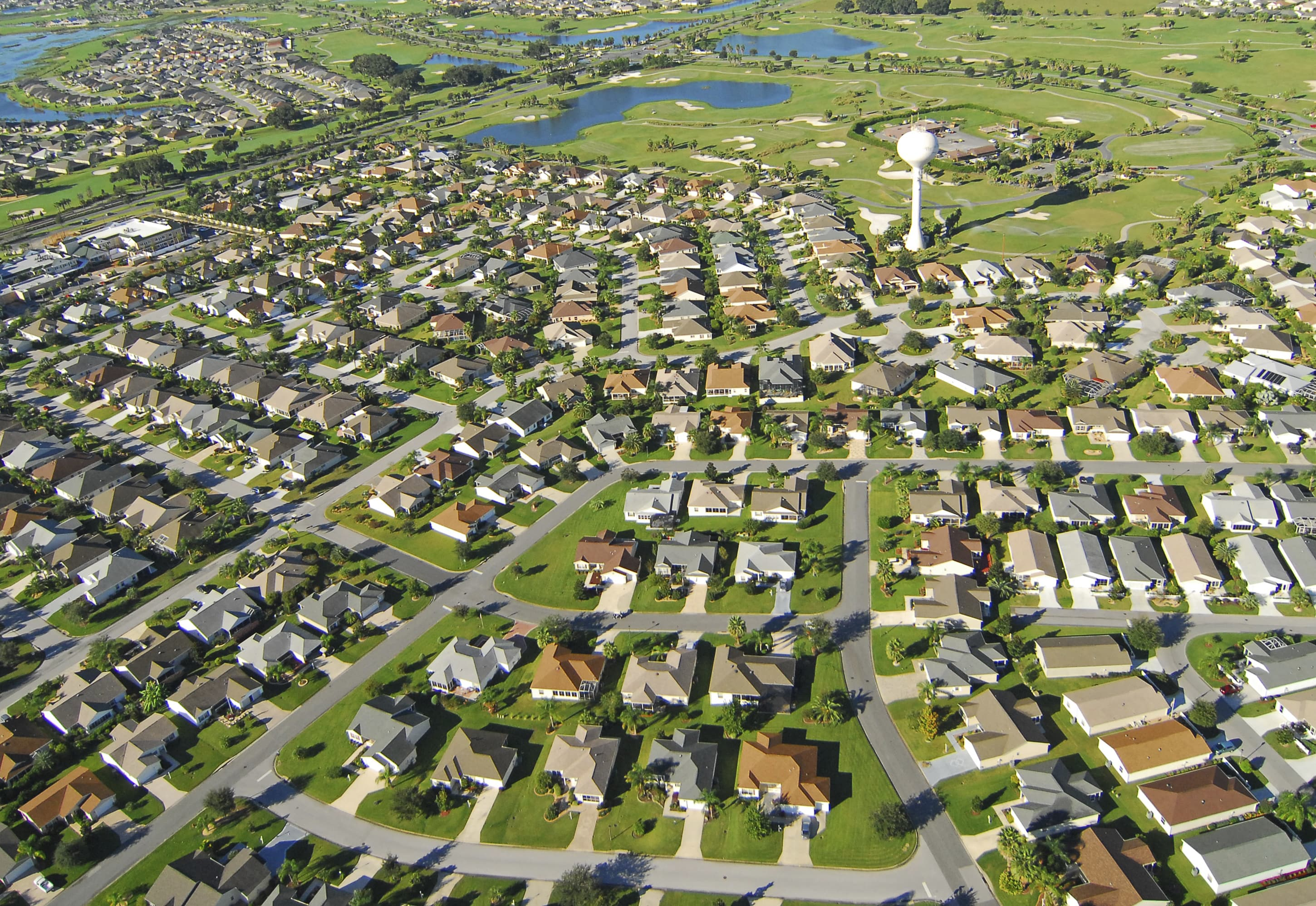 Premium: Aerial view of new homes and golf course in The Villages, Florida.