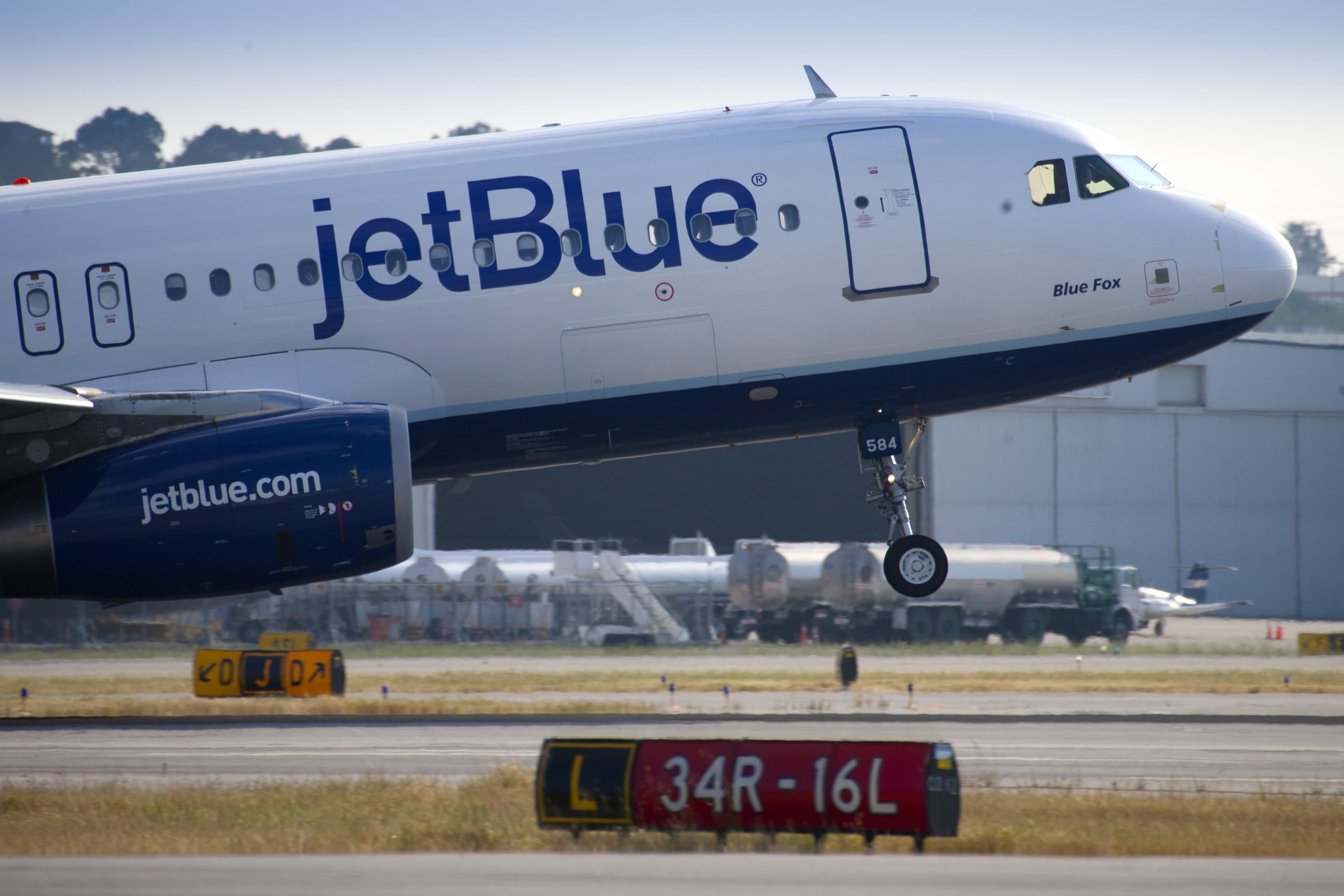 A Jet Blue aircraft takes off from Long Beach Airport in Long Beach, CA.