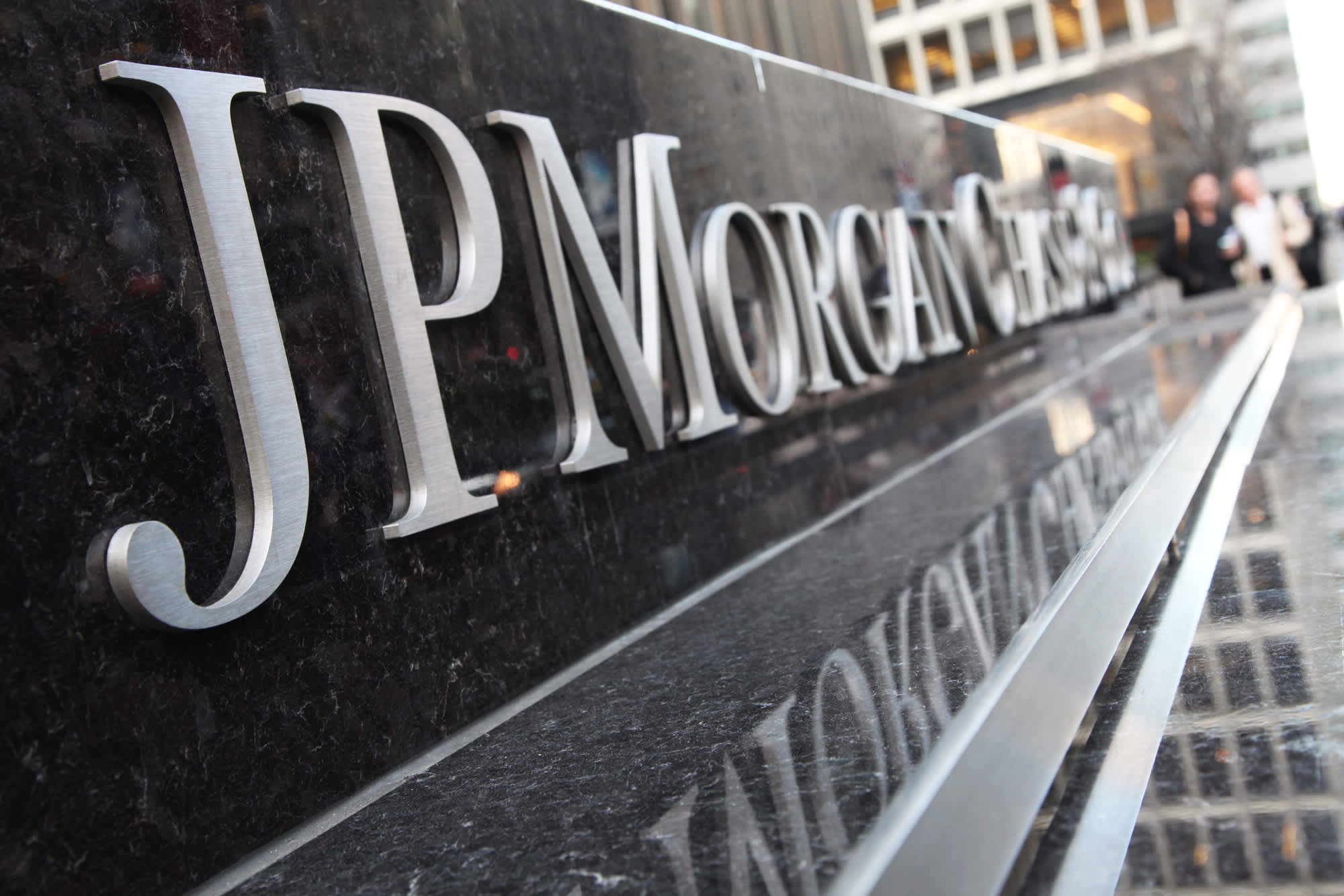 Pedestrians walk in front of the JPMorgan Chase headquarters building in New York.