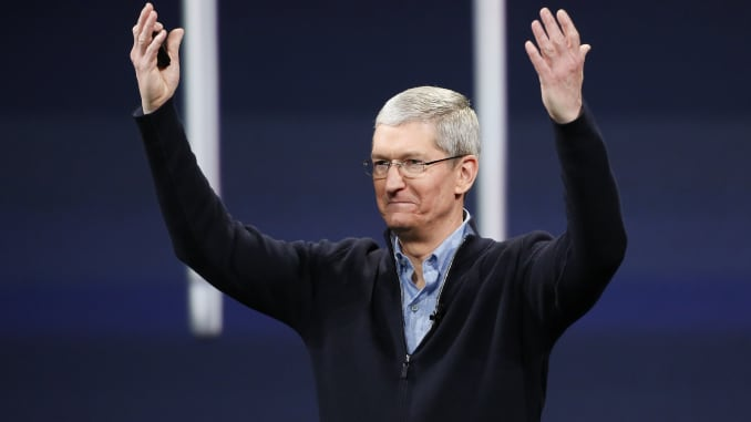 GS: Tim Cook arms raised happy 150309
