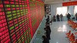 Investors check the share prices at a security firm in Shaoxing, China.