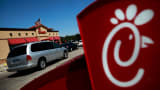 Drive-through customers wait in line at a Chick-fil-A restaurant in Fort Worth, Texas.