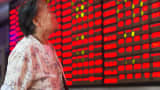 An investor observes stock prices in Nanjing, China.