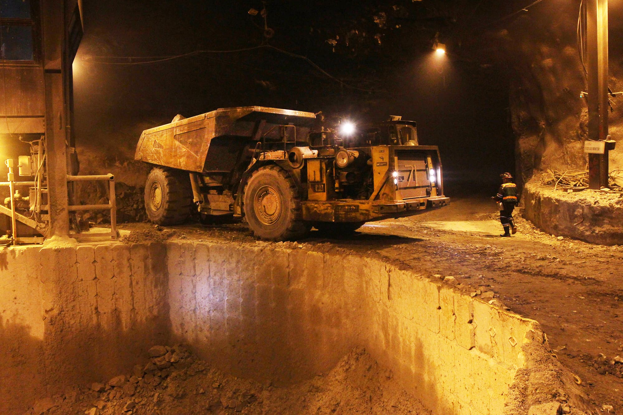 A dump truck is prepared to unload ore into a crusher at Freeport McMoRan's Grasberg copper and gold mining complex in Papua province, Indonesia.