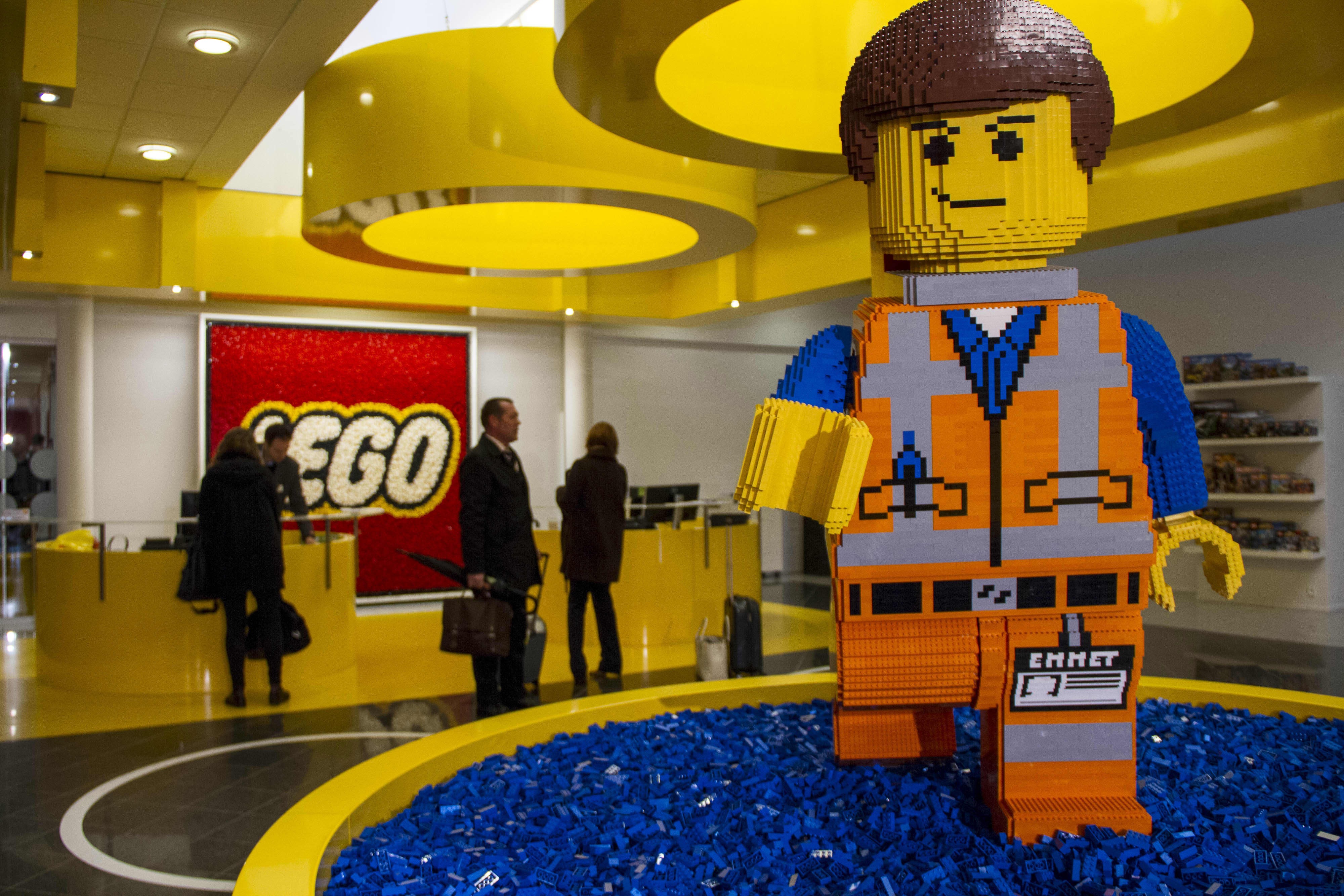 A Lego brick figurine of Emmet Brickowoski, a character from 'The Lego Movie', stands in the reception area at the headquarters of Lego A/S in Billund, Denmark.