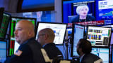 Traders work while Janet Yellen appears on television, on the floor of the New York Stock Exchange, September 17, 2015..