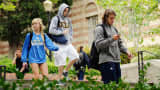 Students walk across the campus of UCLA in Los Angeles.