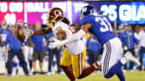Andre Roberts of the Washington Redskins attempts to catch a pass against Trevin Wade of the New York Giants at MetLife Stadium on Sept. 24, 2015, in East Rutherford, New Jersey.