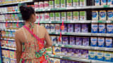 A customer shops for baby milk in a supermarket in Haikou, China.