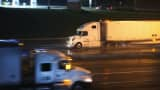 Truck drivers navigate a rain-covered highway on the outskirts of Chicago.