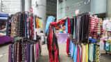 A woman looks at clothing at a market stall in Putrajaya, Malaysia.