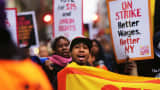 Low wage workers and supporters protest for a $15 an hour minimum wage on November 10, 2015 in New York.