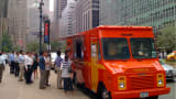 A Mexicue Food Truck serves customers on Park Avenue in New York.