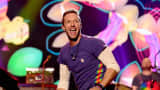 Chris Martin of Coldplay performs onstage during the 2015 American Music Awards
