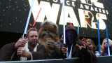 "Fans dressed up as ""Star Wars"" character pose ahead of the European premiere of ""Star Wars The Force Awakens"" in central London on Dec. 16, 2015."